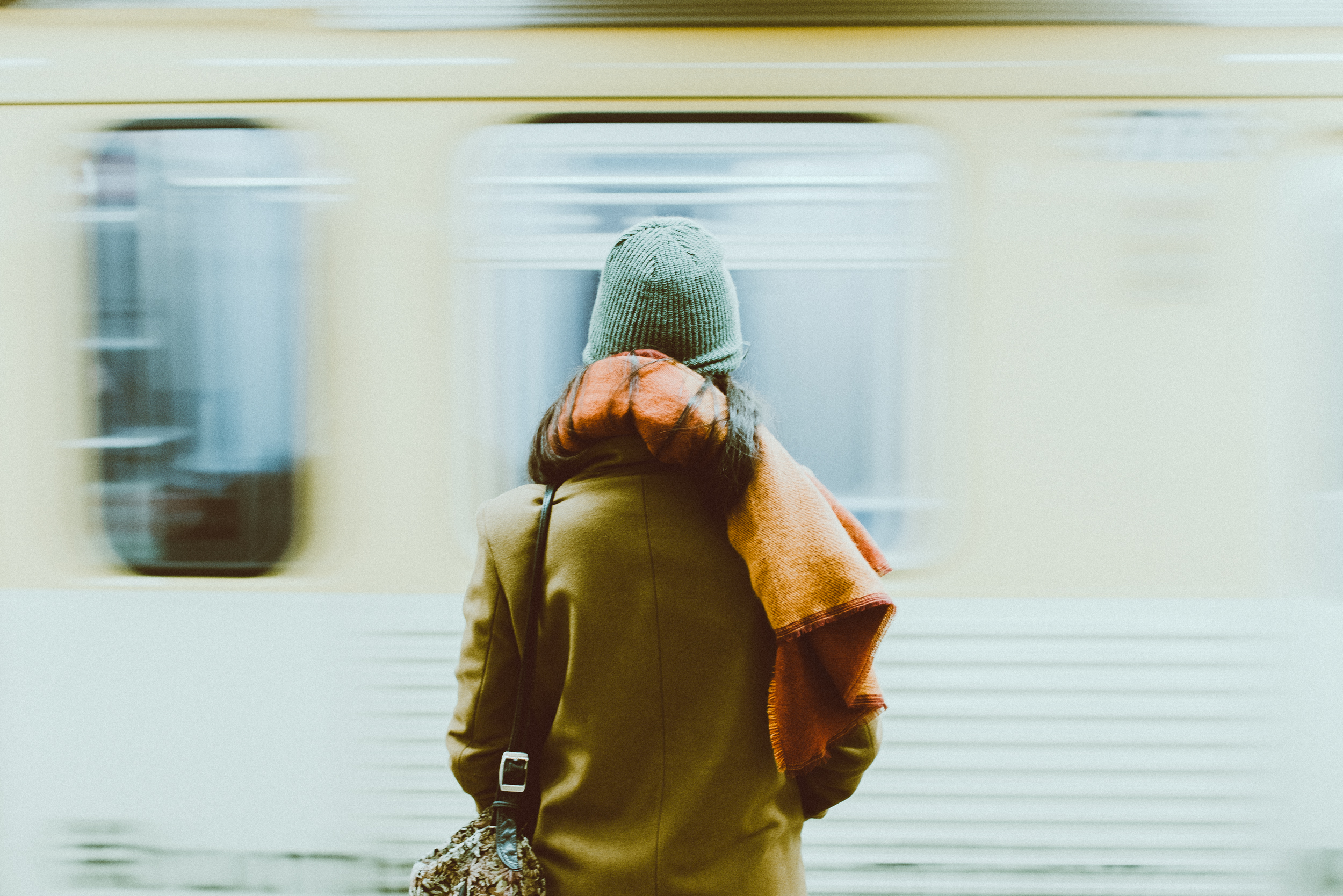 Time-Lapse Photography of Person Standing Near Train