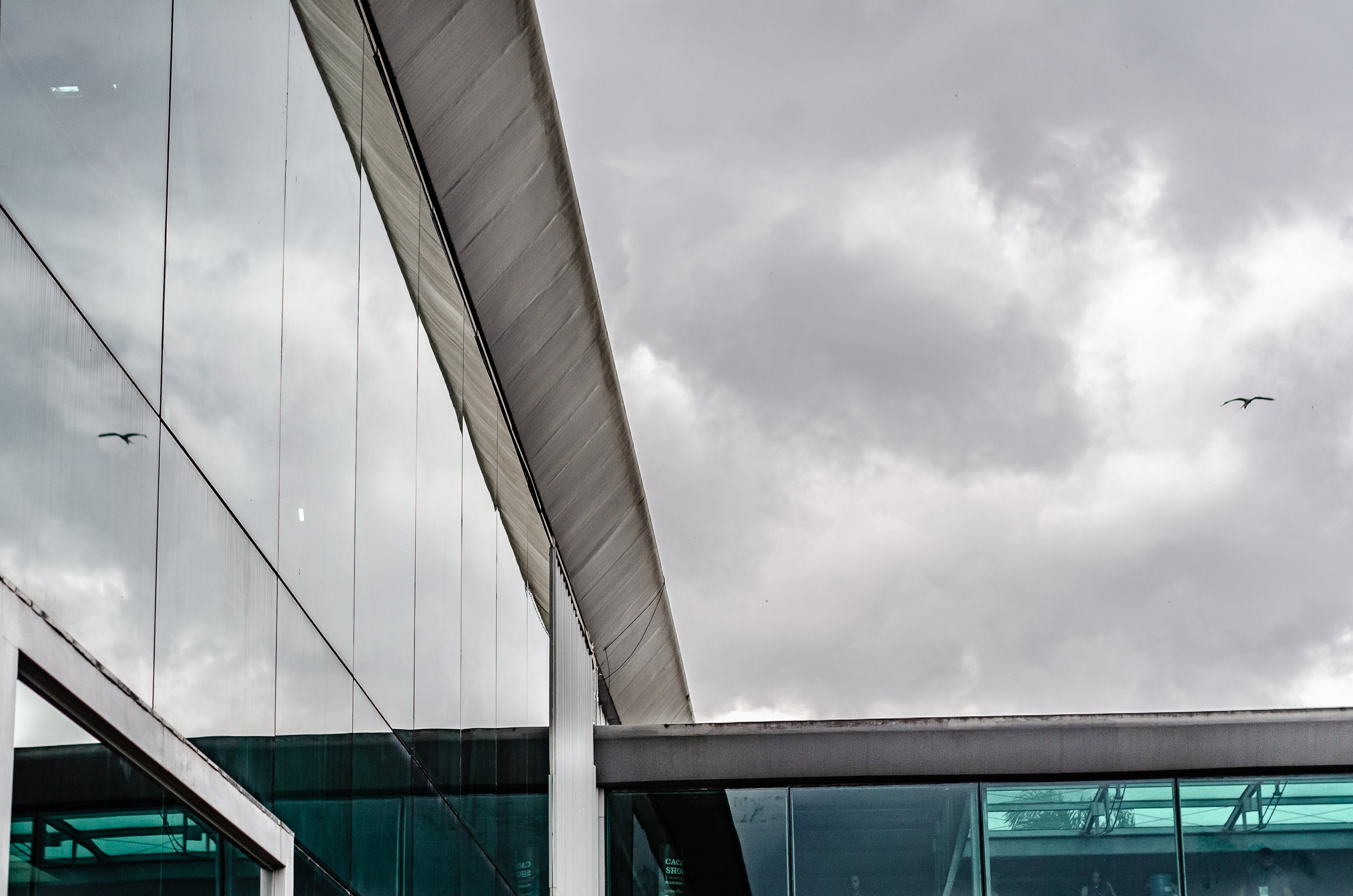 Photo of Glass Building Under Cloudy Sky