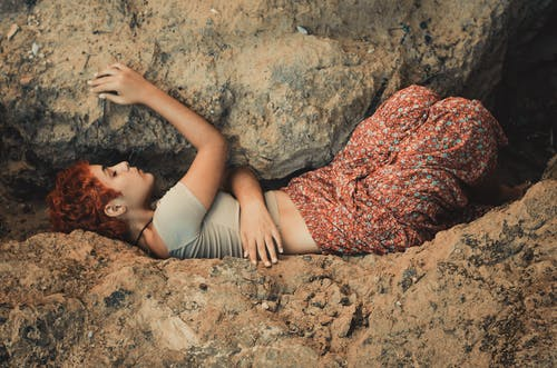 Woman Lying in Between Boulders