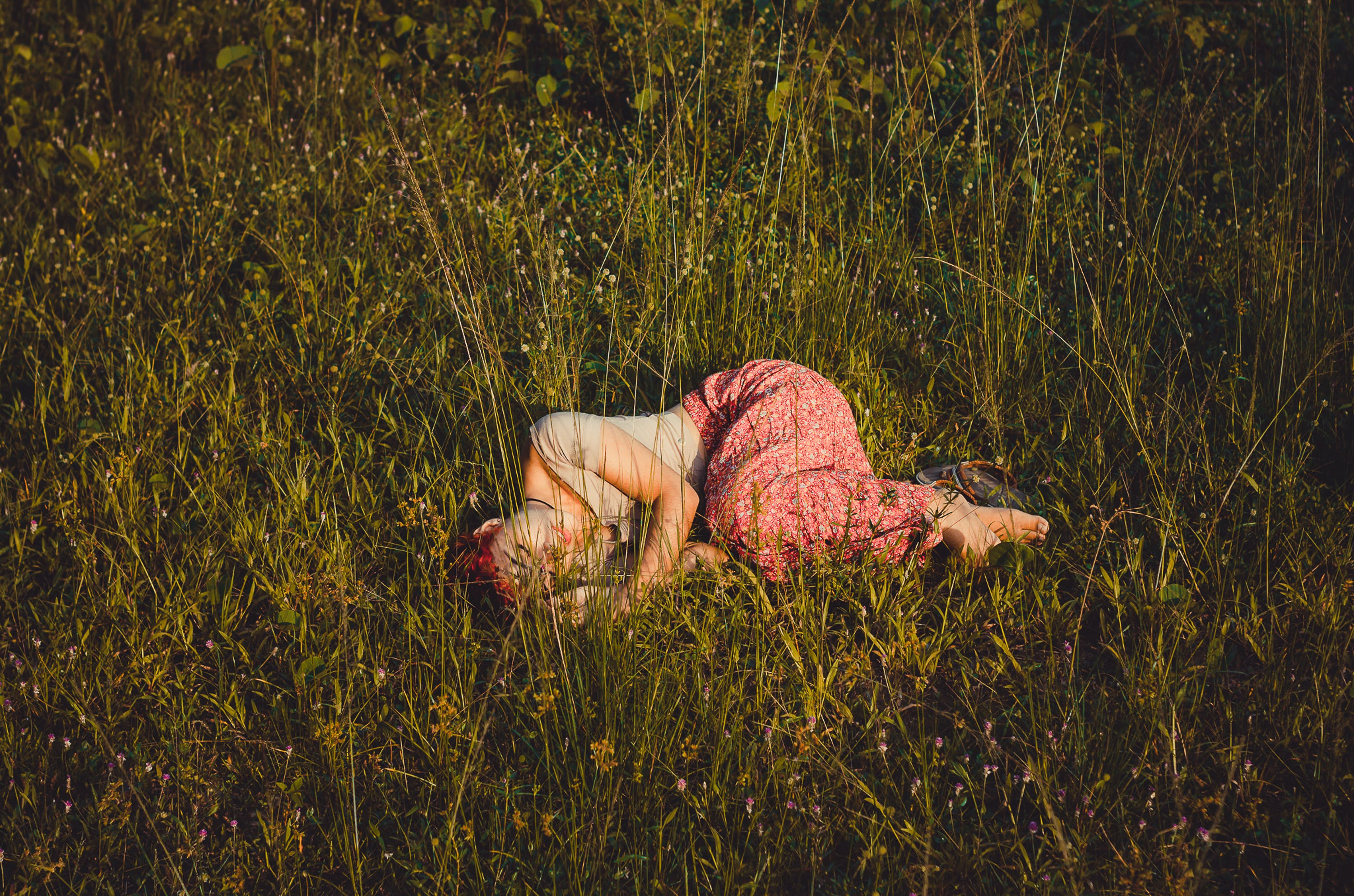 Photo of Woman Lying on Grass