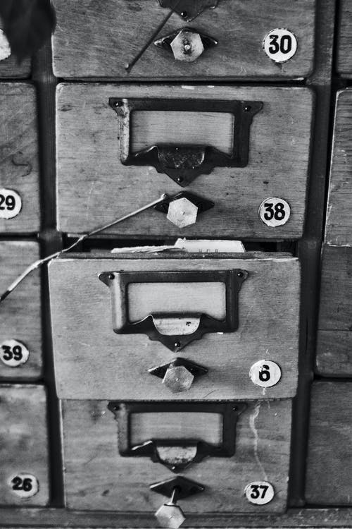 Grayscale Photography Of Drawer
