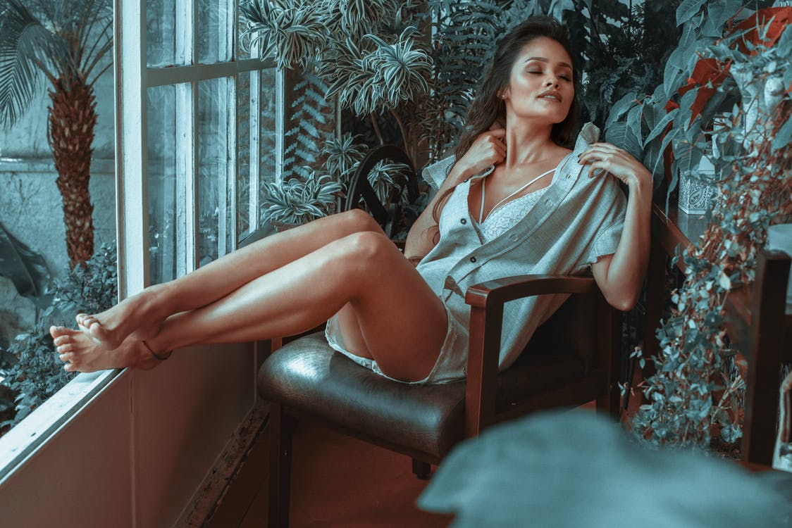 Woman Sitting on Leather Padded Armchair
