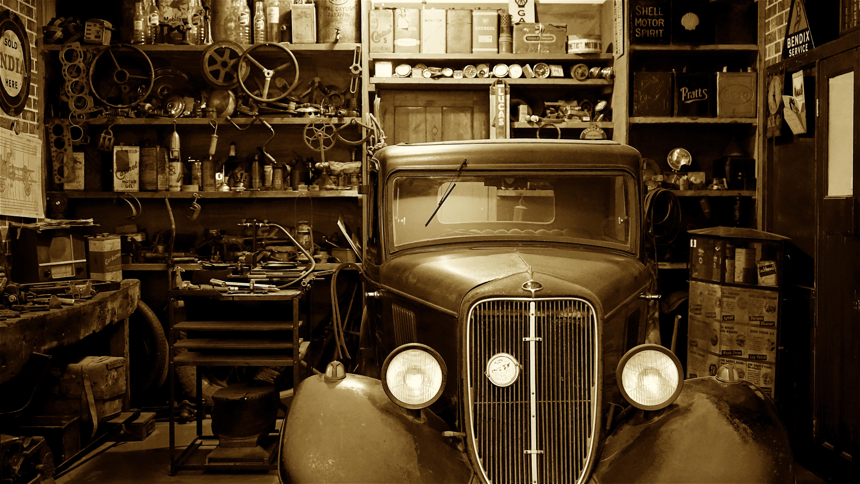 Black Vintage Car on Garage