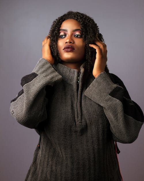 Photo of Woman Wearing Grey Sweater