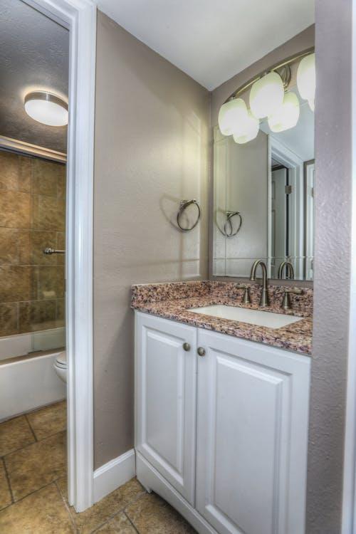 Free stock photo of bathroom, cabinet, faucet, interior design