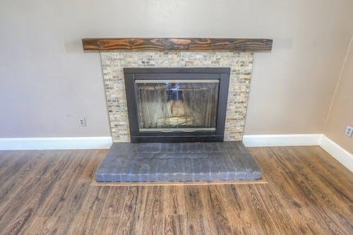 Free stock photo of fireplace, flooring, interior design, wooden flooring
