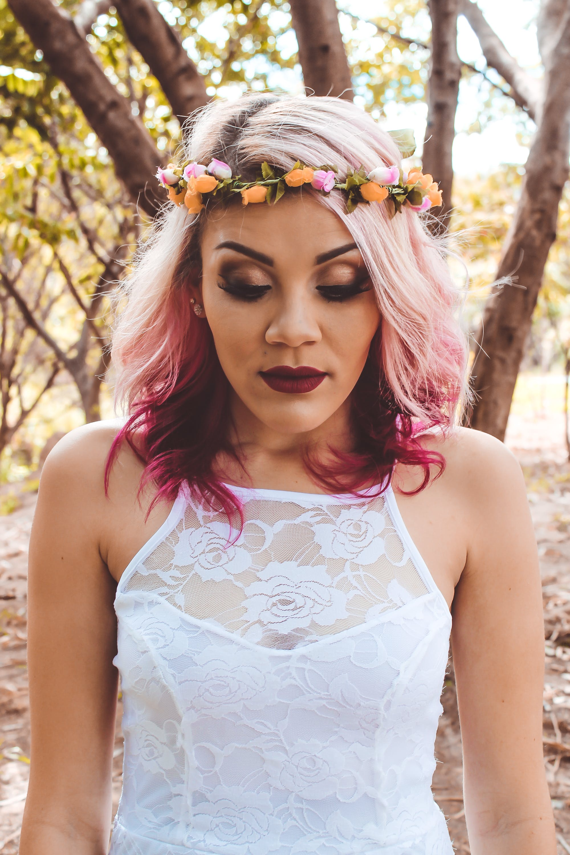 Close-up Photo of Woman in Flower Crown and White Lace Top