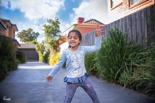 Free stock photo of dancing kid, happy kid, little girl, portrait photography