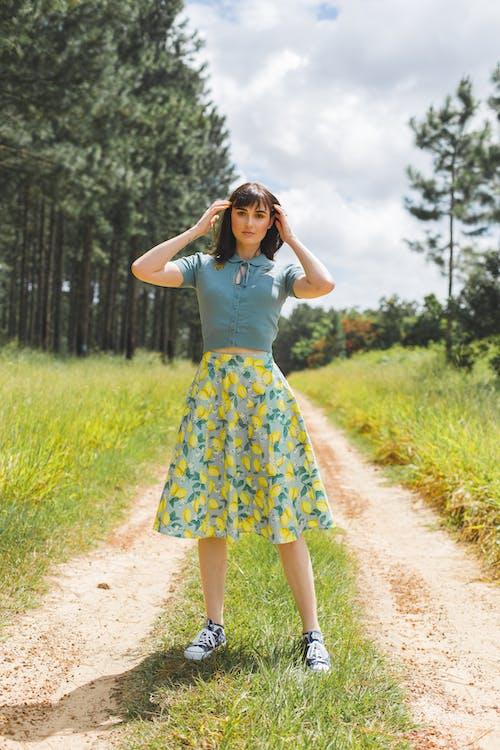 Standing Woman On Green Grass