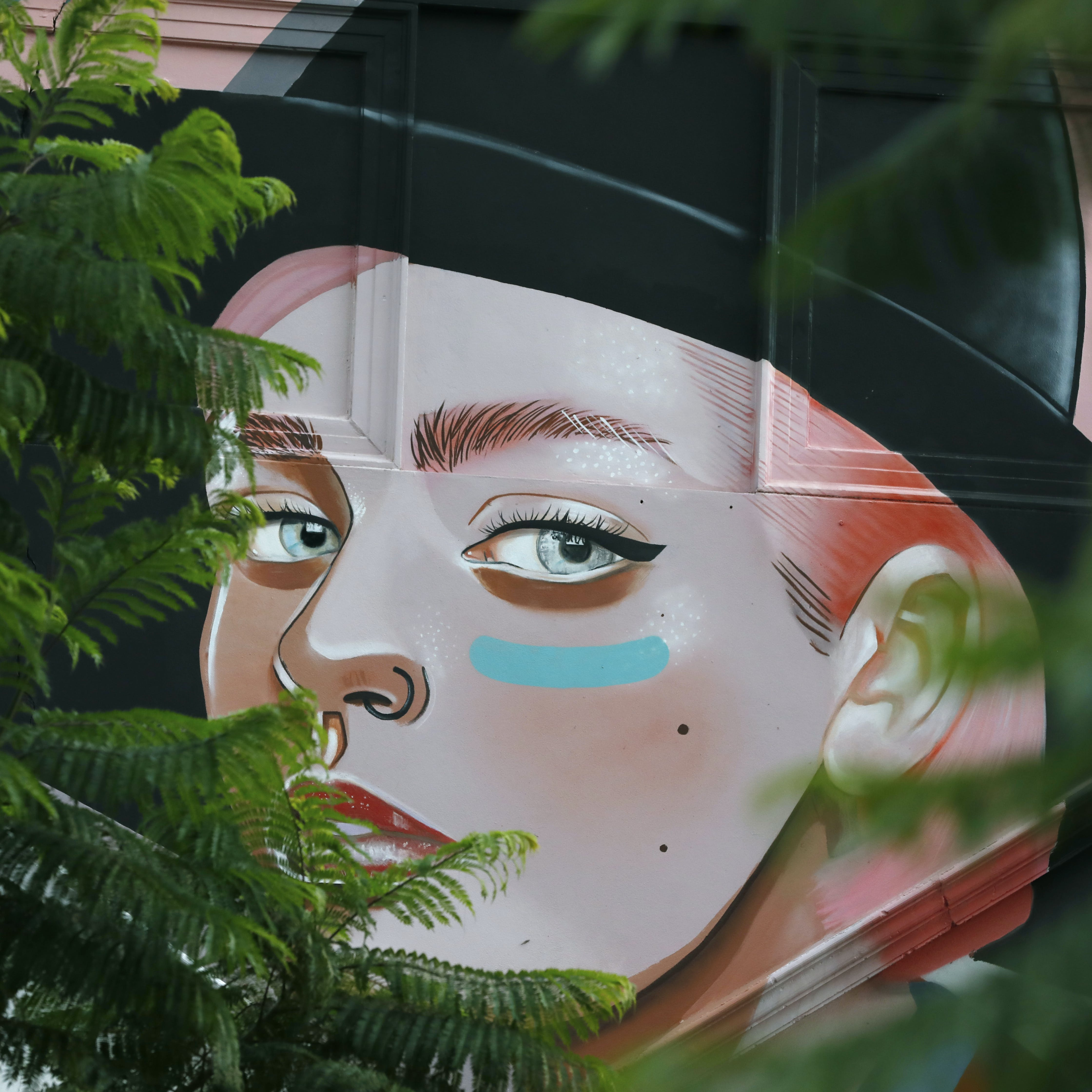 Woman Wearing Black Hat Graffiti
