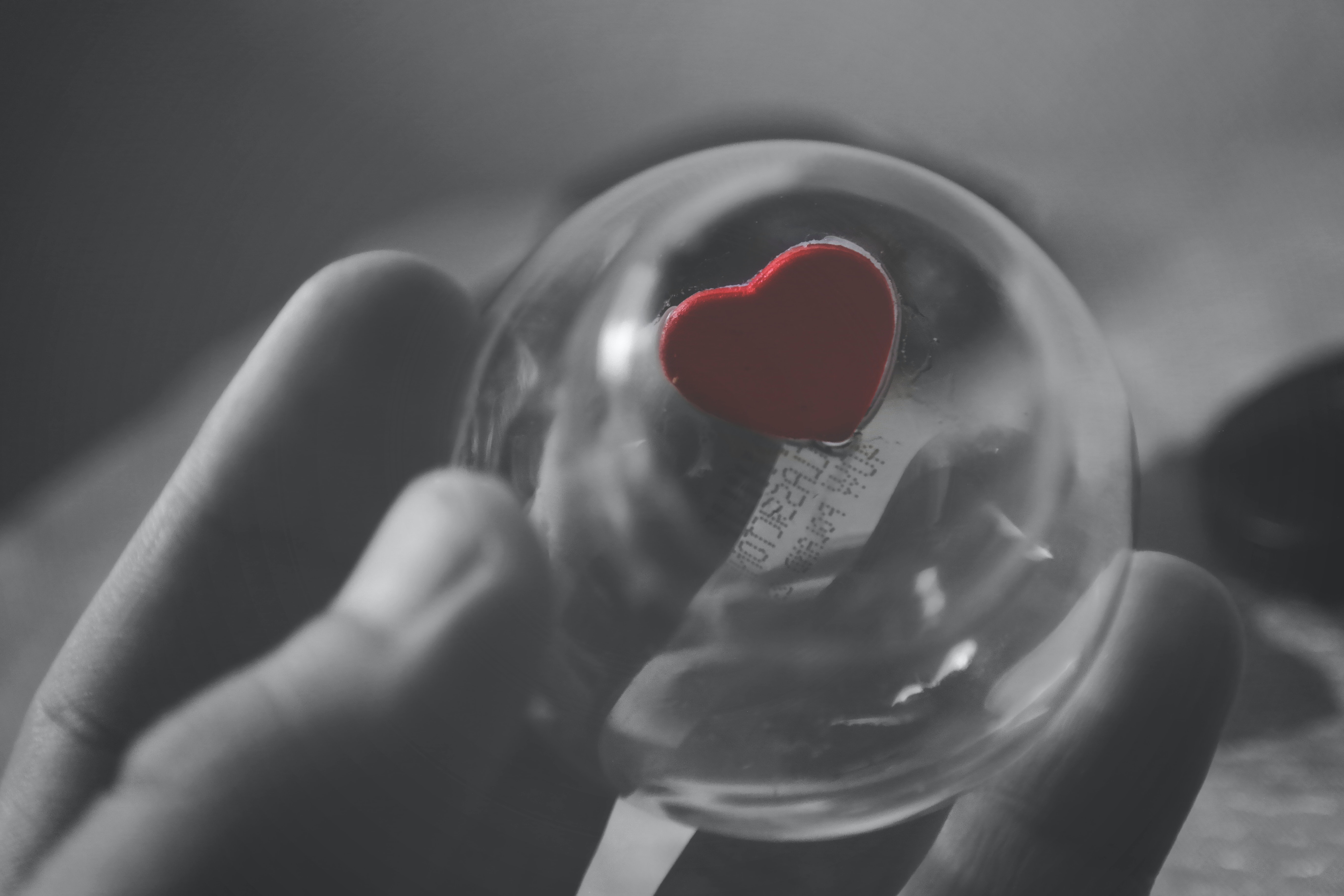 Selective color of red heart ball photography · free stock photo
