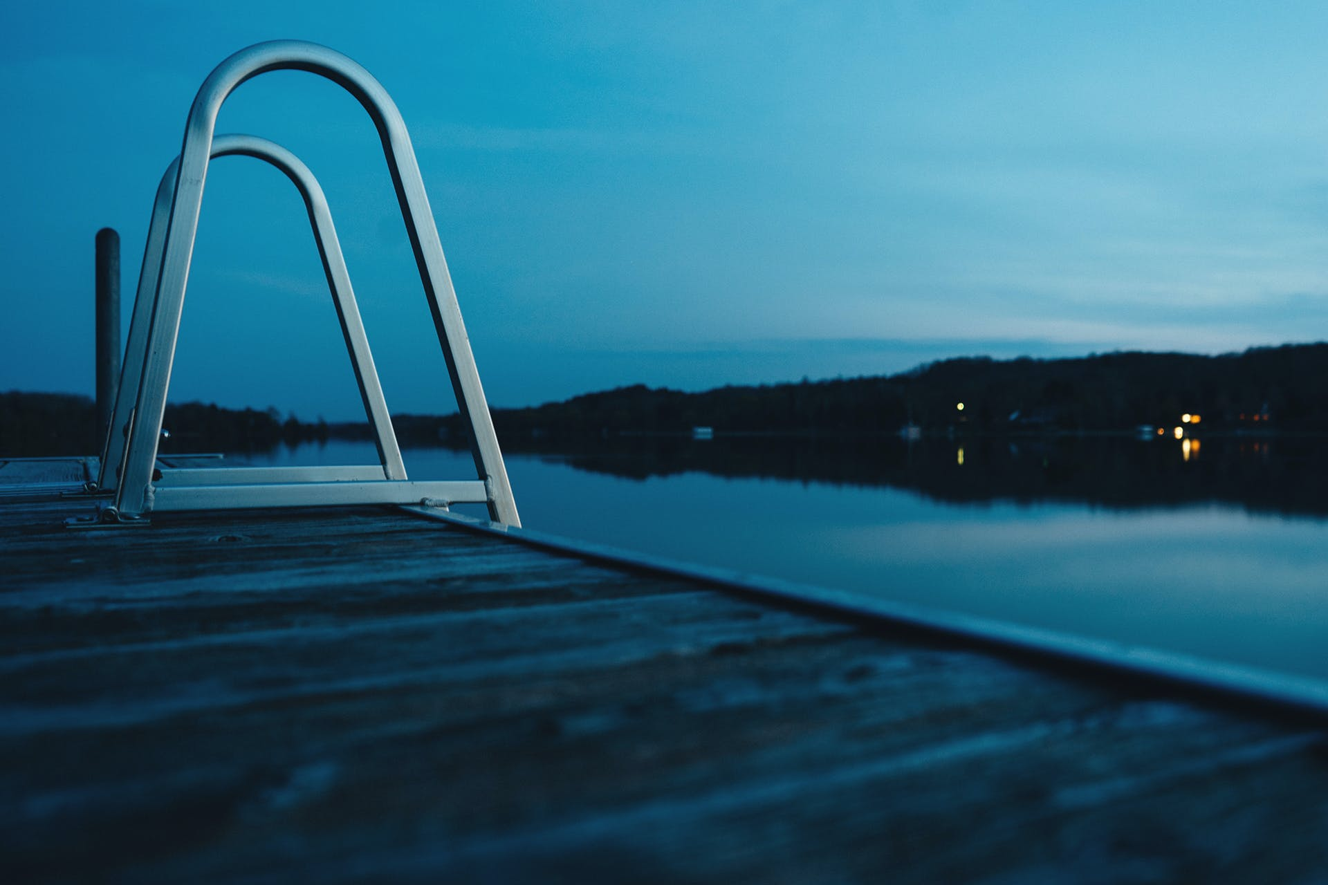 Stainless Steel Side Ladder Near Body of Water