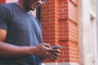 Man Using Gray Iphone 6