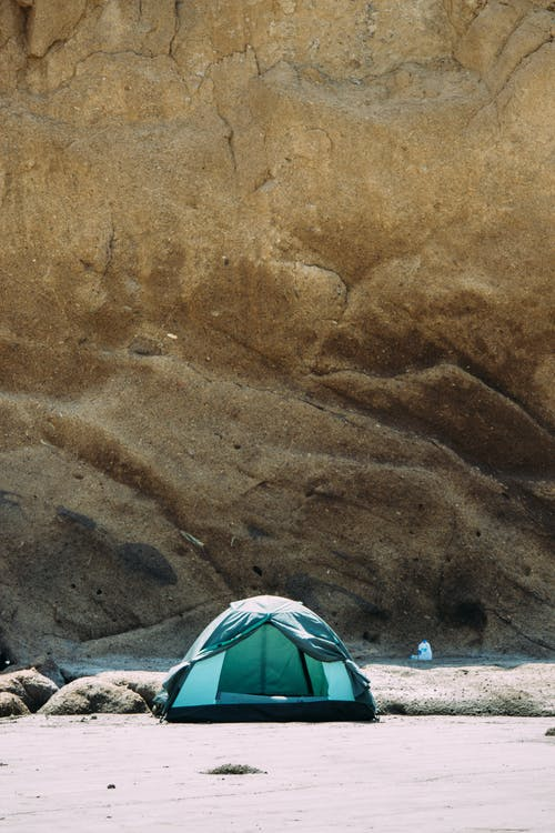 Black and Green Camping Dome Tent Near Mountain