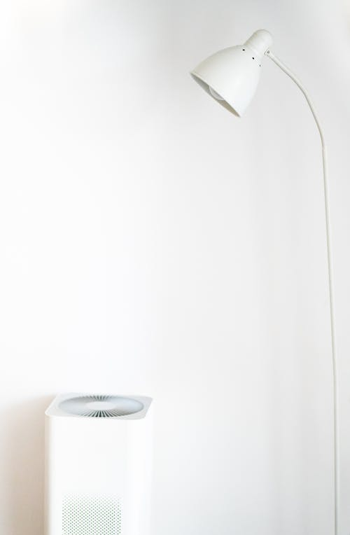 White Floor Lamp Beside White Painted Wall