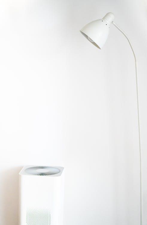 White Floor Lamp Beside White Painted Wall