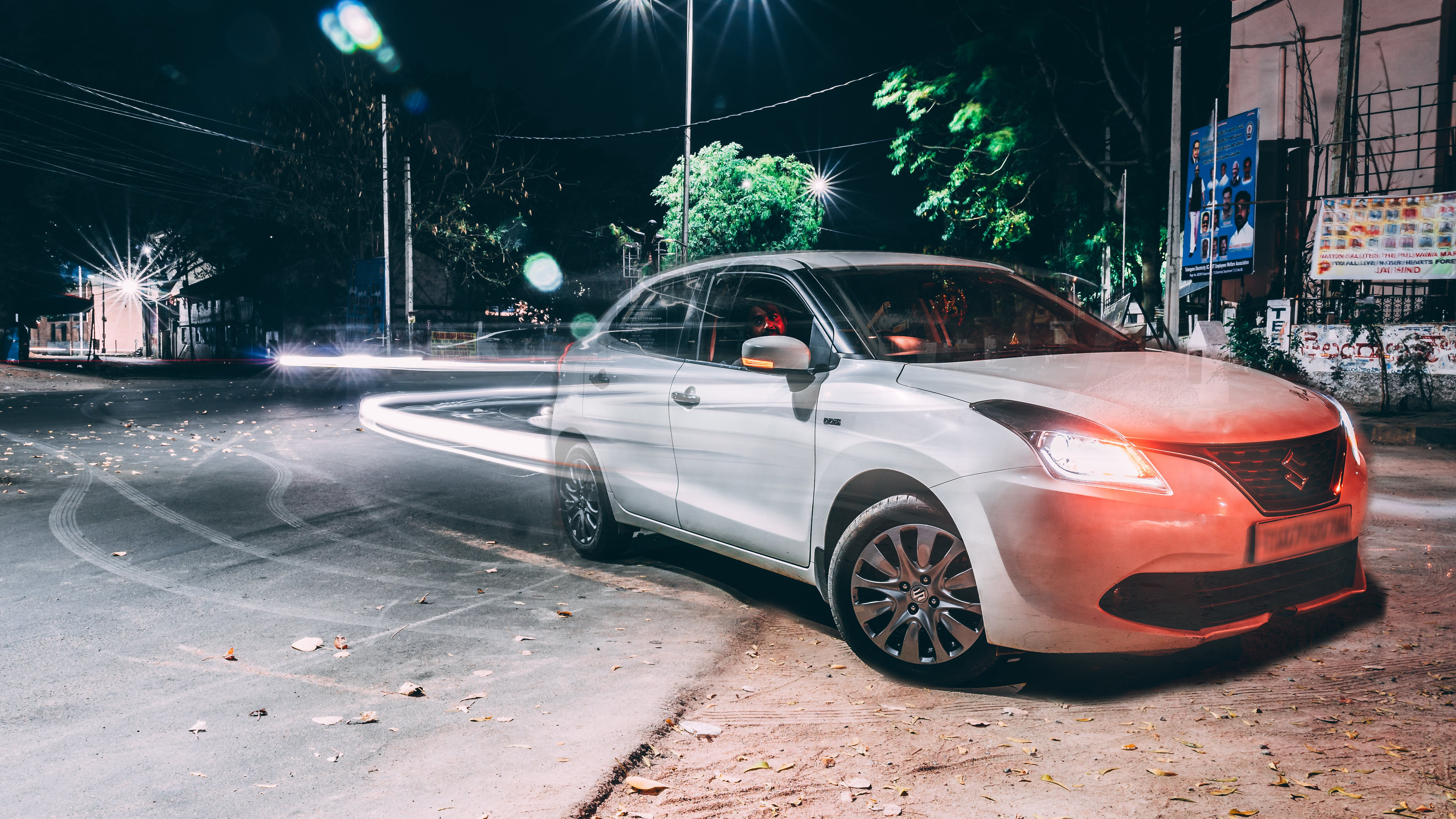 Long Exposure Photography of Silver Suzuki Dezire on Road