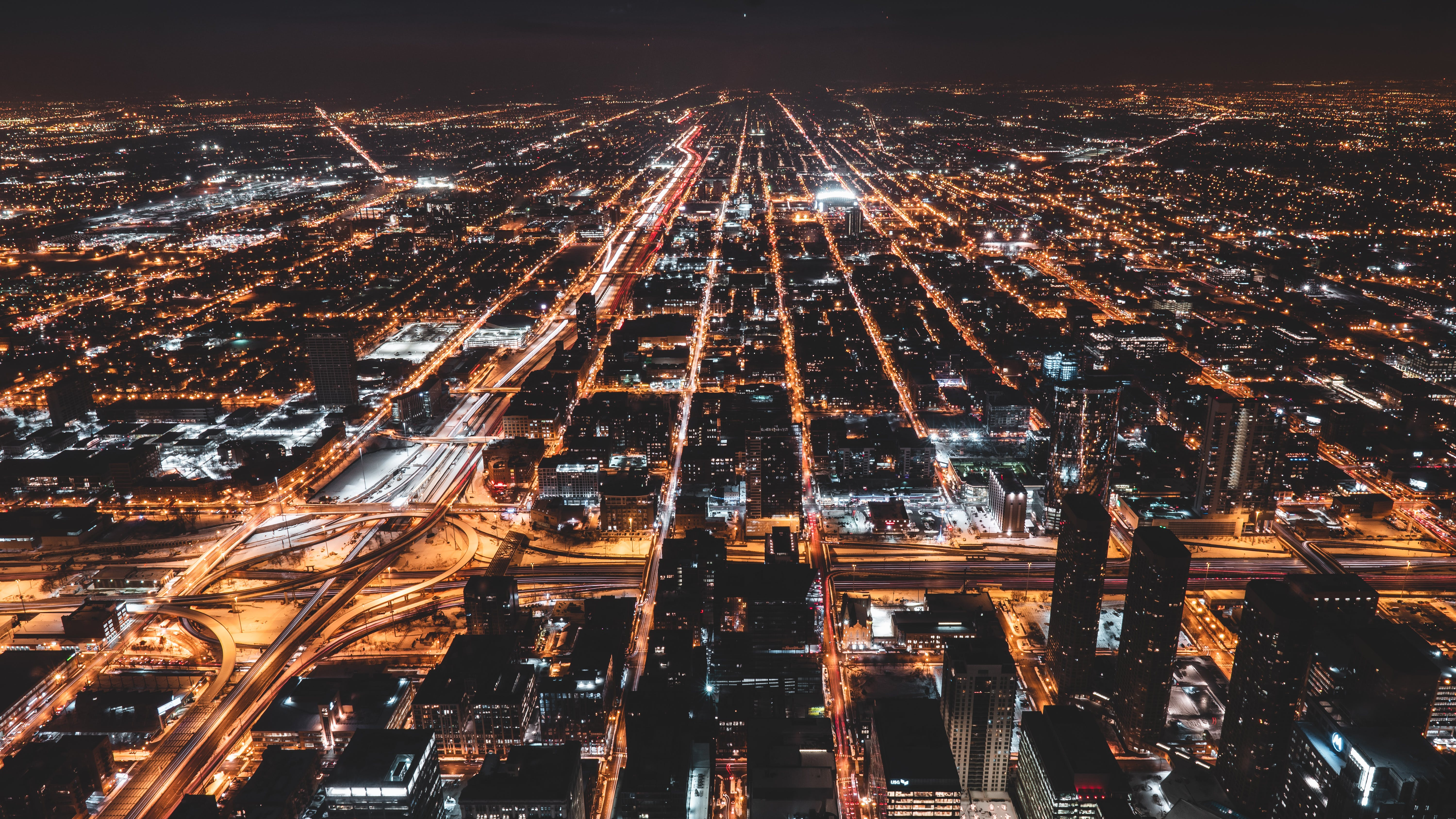 Aerial Photography Of City Buildings With Lights Turned On At Night