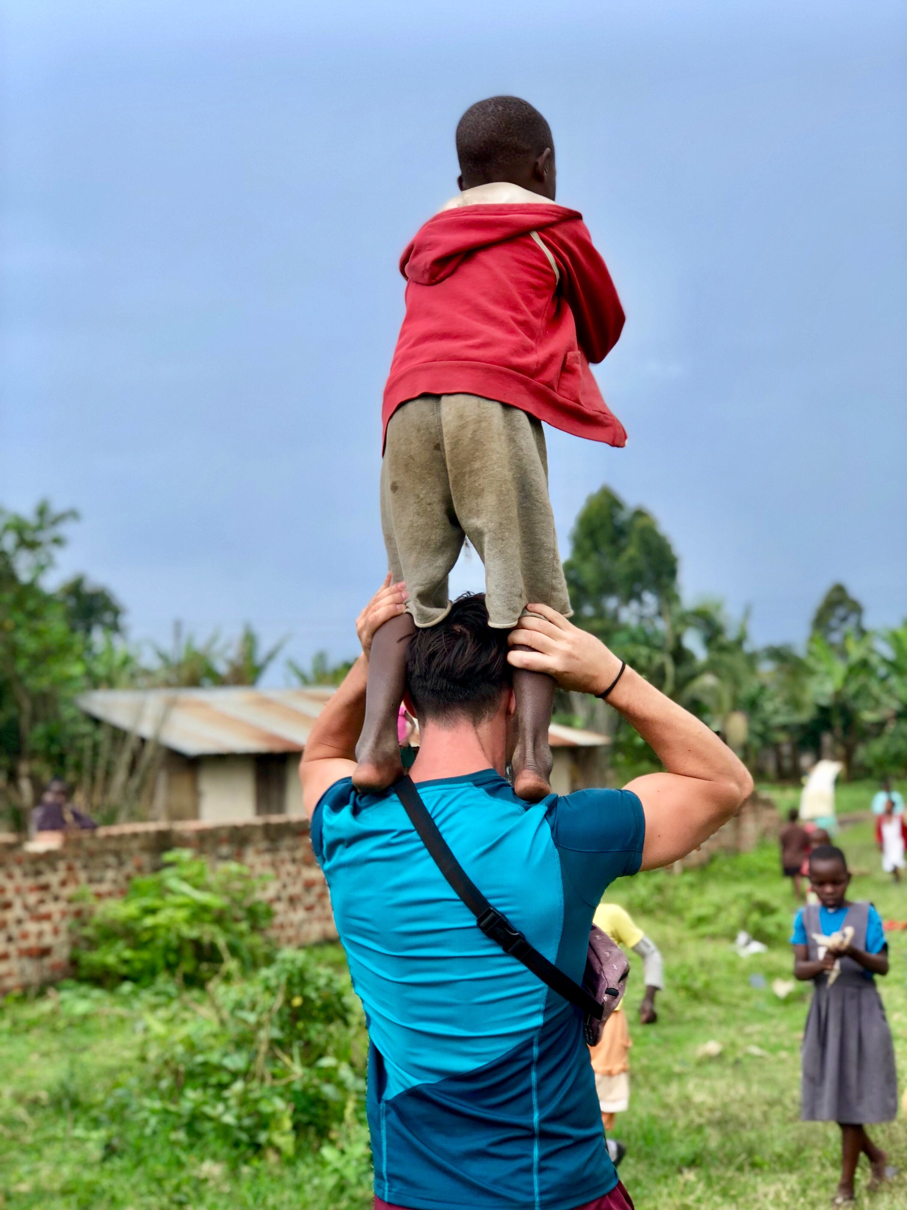 Man Carrying Boy On Shoulders