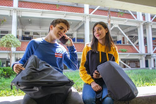 Free stock photo of backpack, couple, school, teen