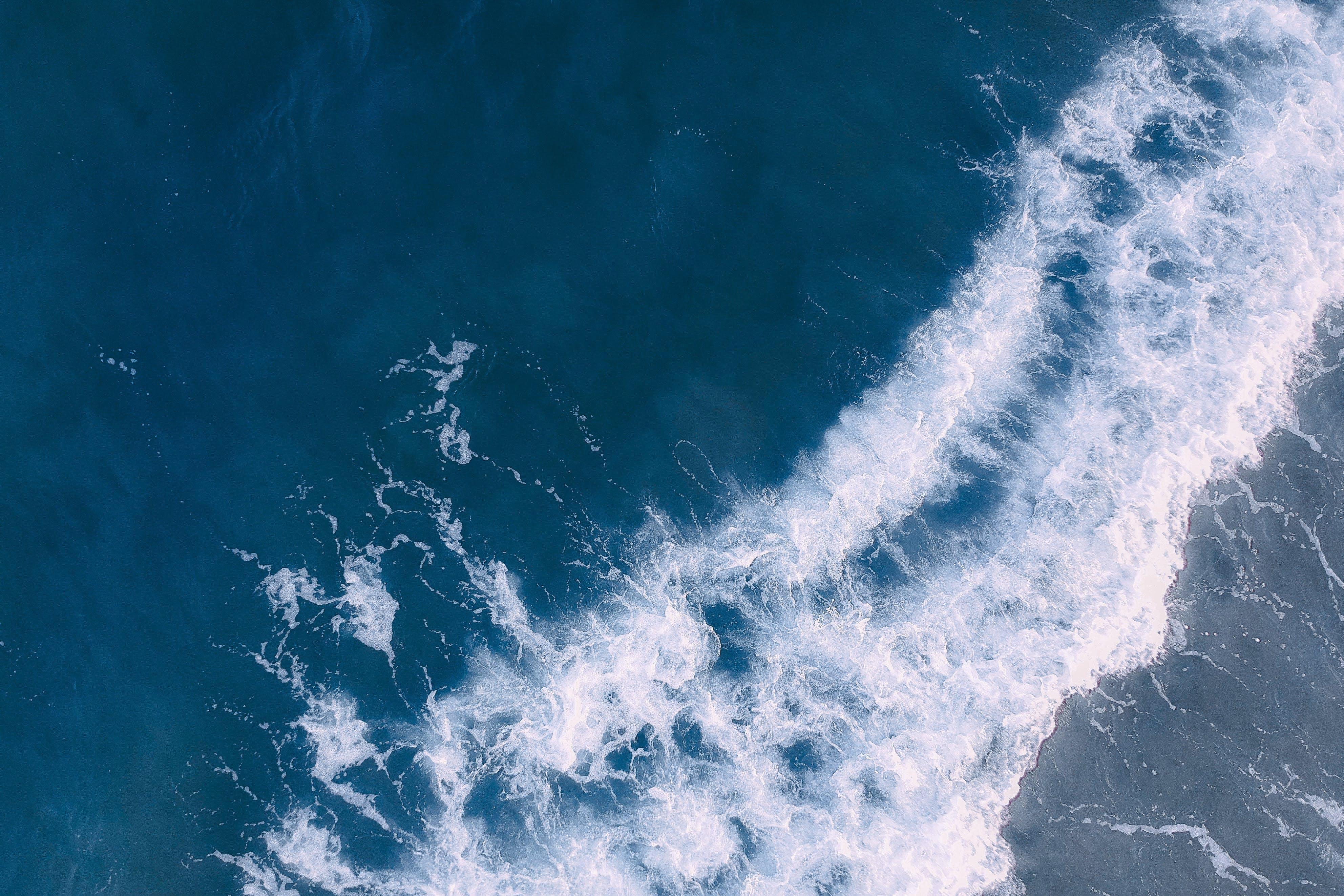 Foto profissional grátis de aerofotografia, água, ao ar livre, borrifar