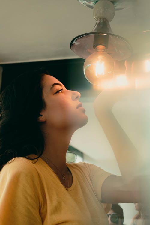 Woman Holding Light Bulb