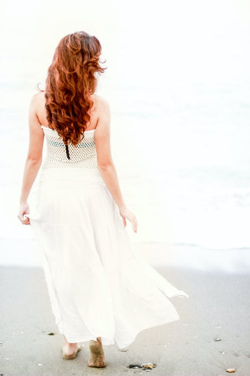 Woman in White Strapless Dress Looking at the Sea