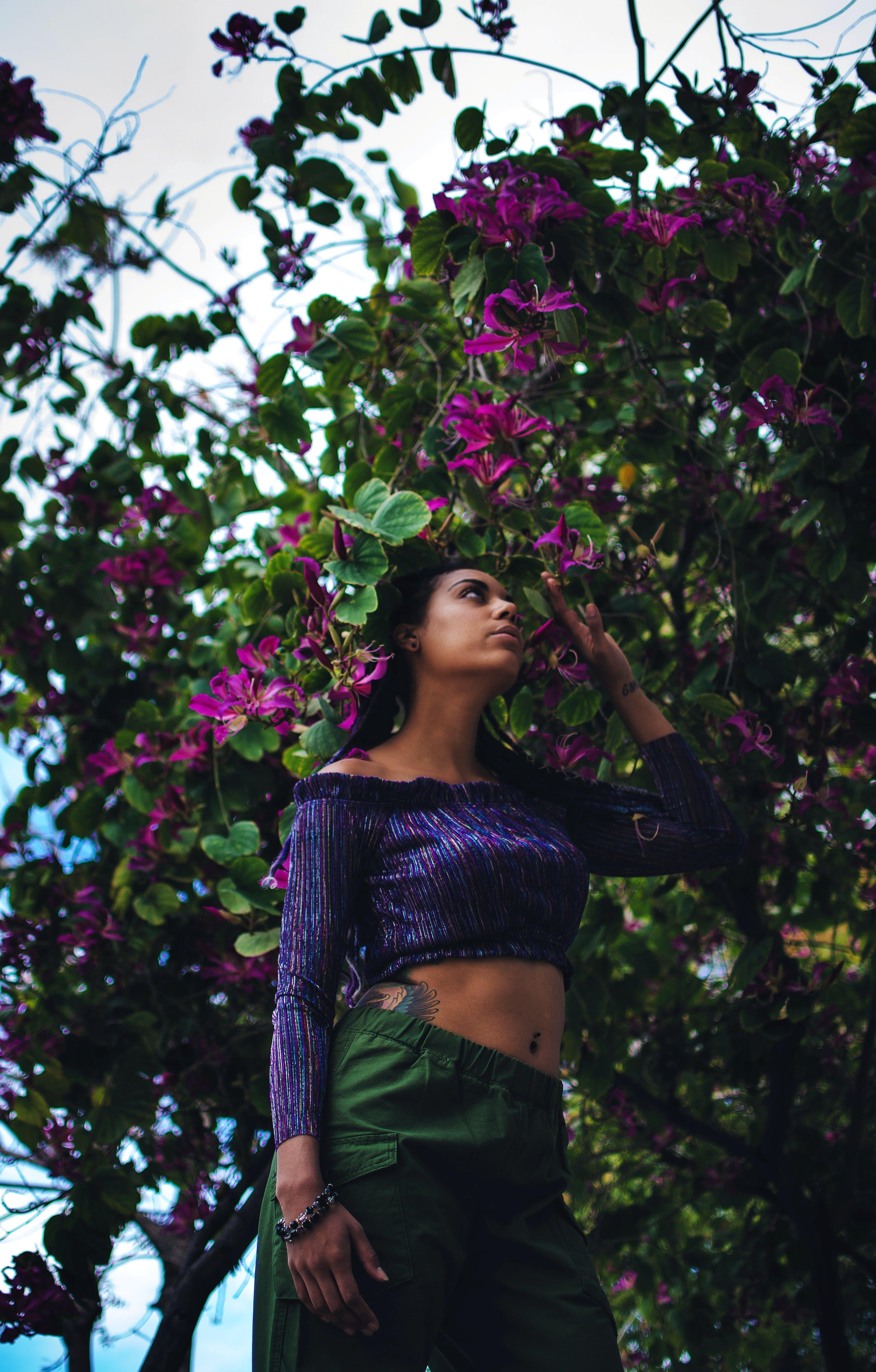 Woman Holding Purple-Petaled Flowers