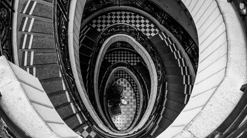 Monochrome Photo of Spiral Staircase