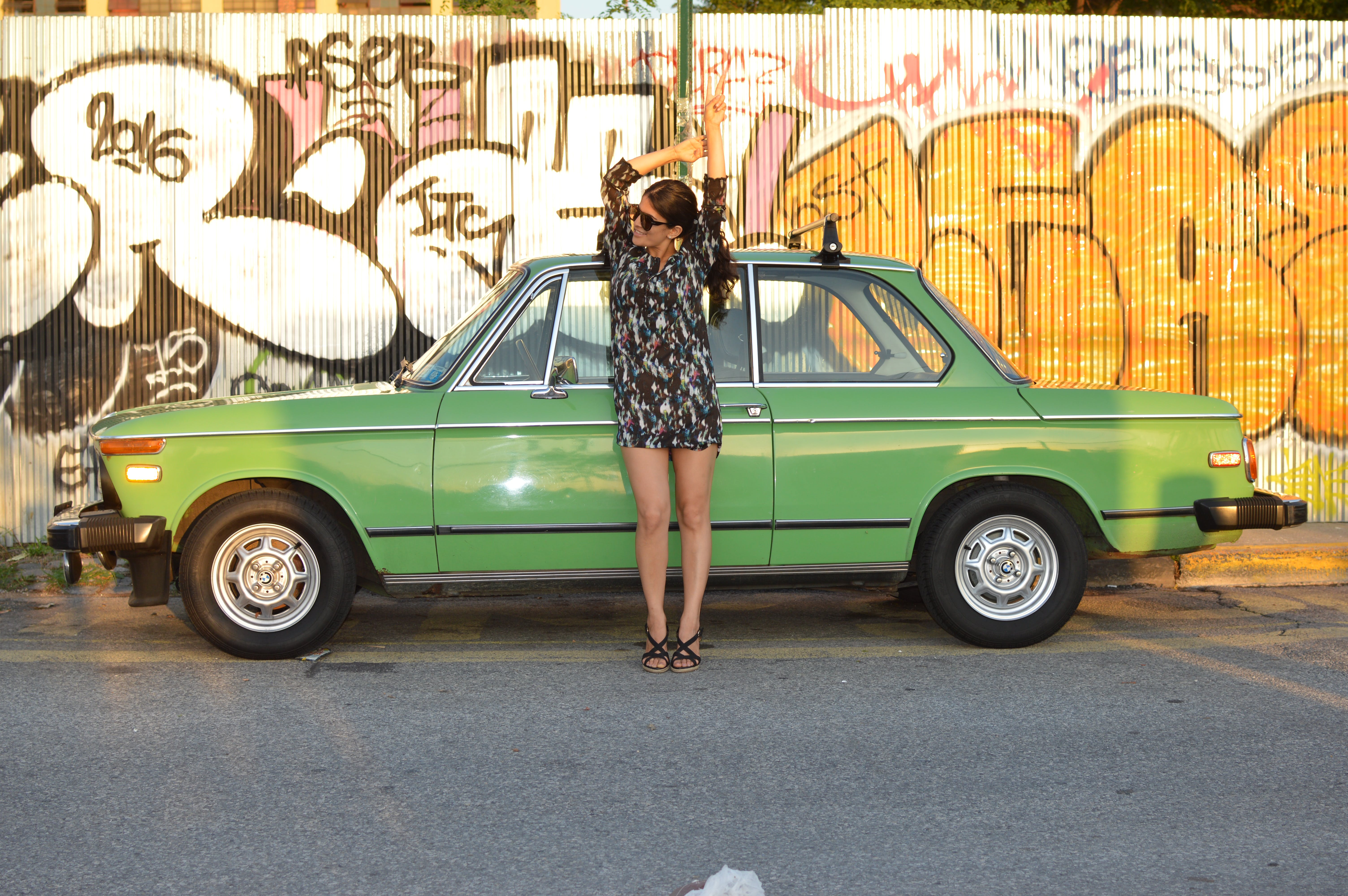 Woman Leaning on Parked Car