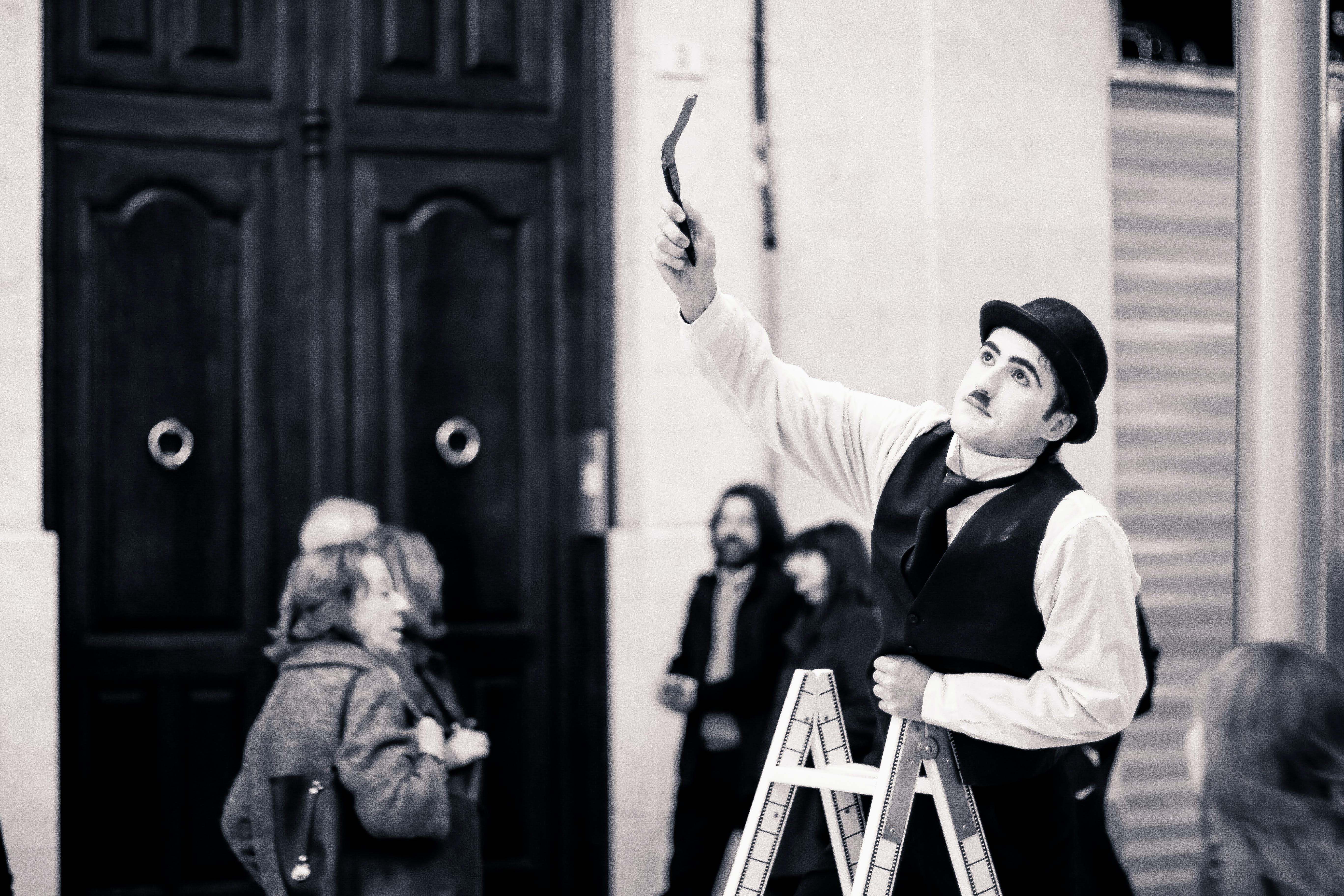Charlie Chaplin on Top of Ladder