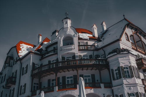 Low Angle Photography of White and Red Mansion