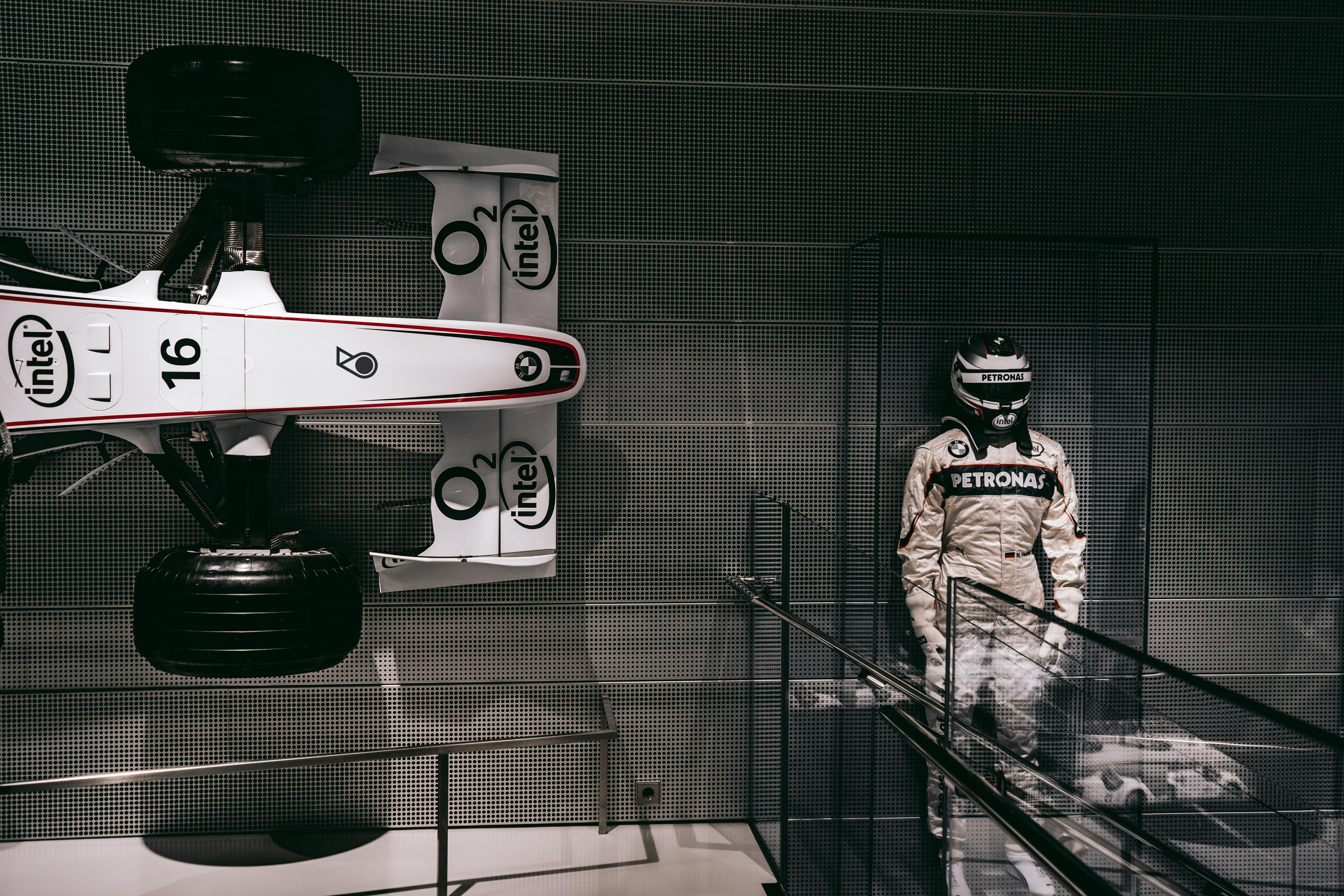F1 Driver Statue Beside F1 Car