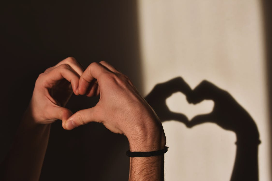 Person Doing Heart Hand Gesture