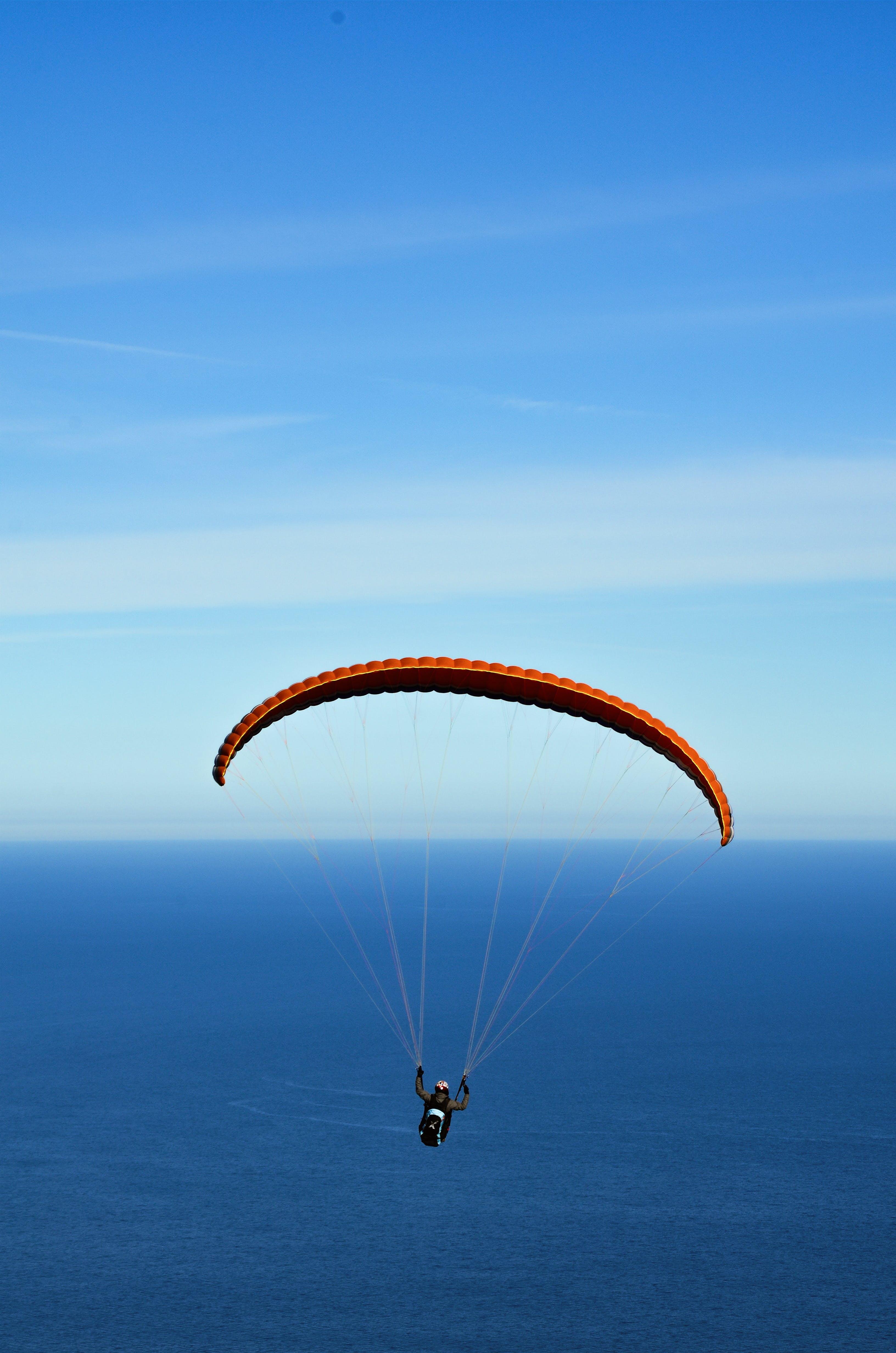 Man on Parachute over Blue Sea