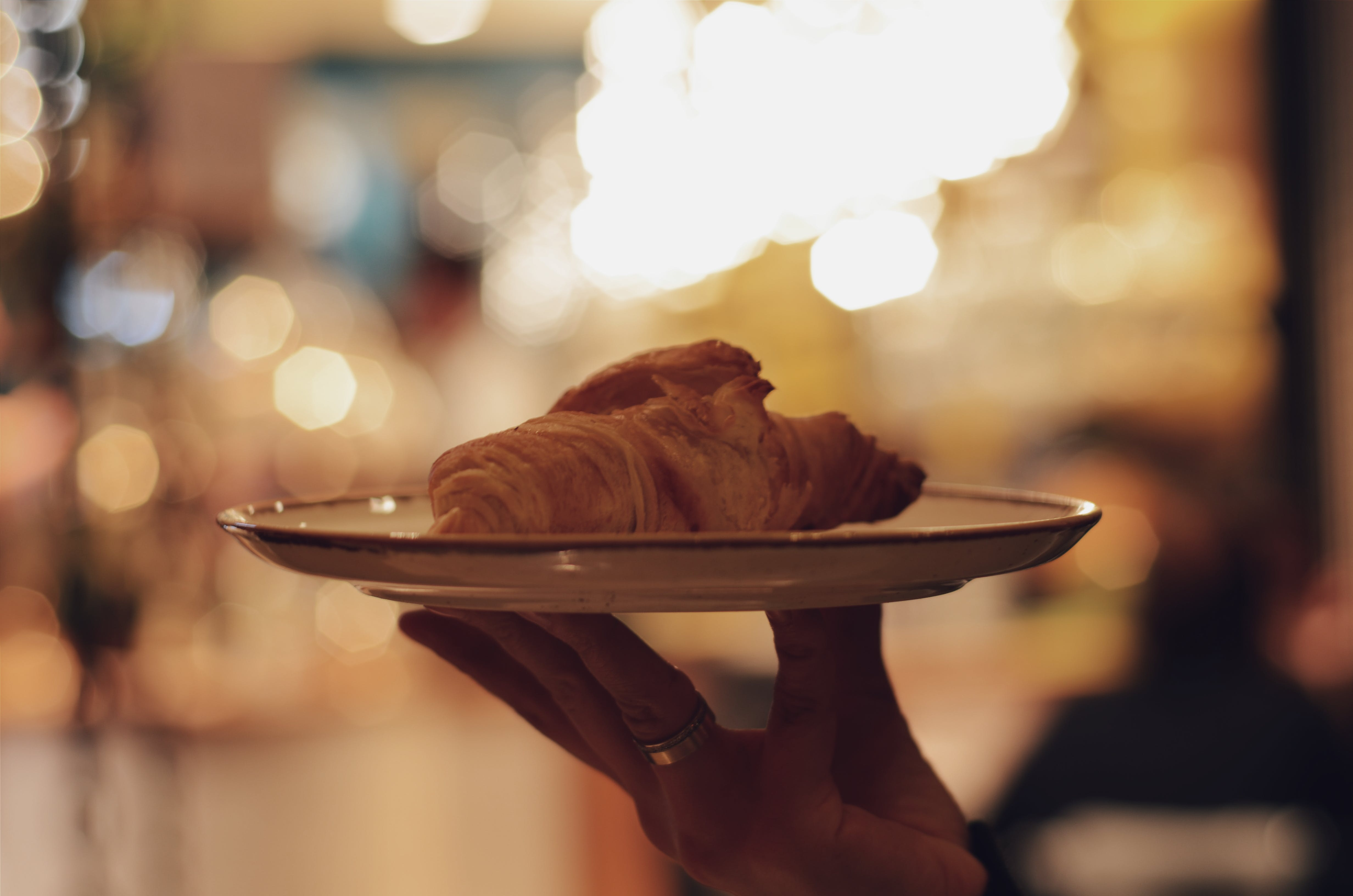 Person Holding Plate of Pastry