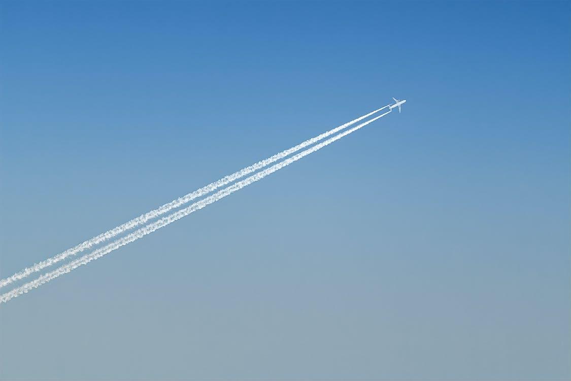 Plane Leaving Cloud Contrails