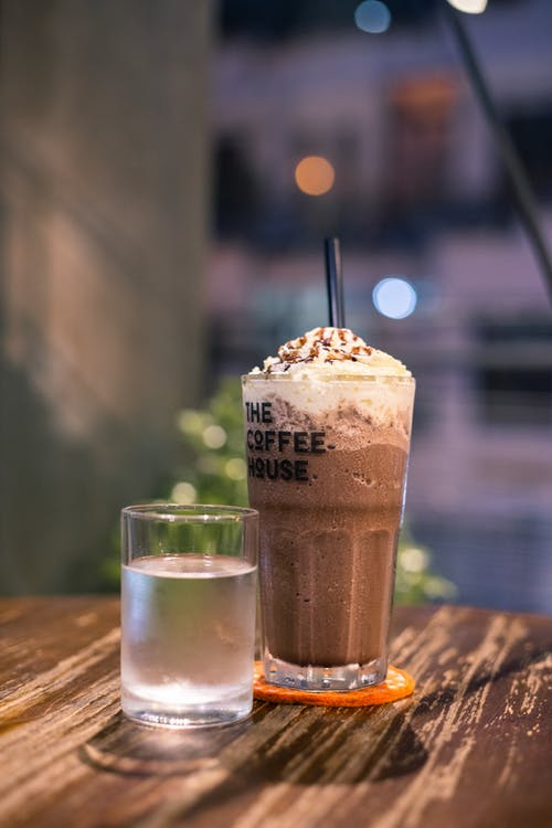 Brown Beverage on Table