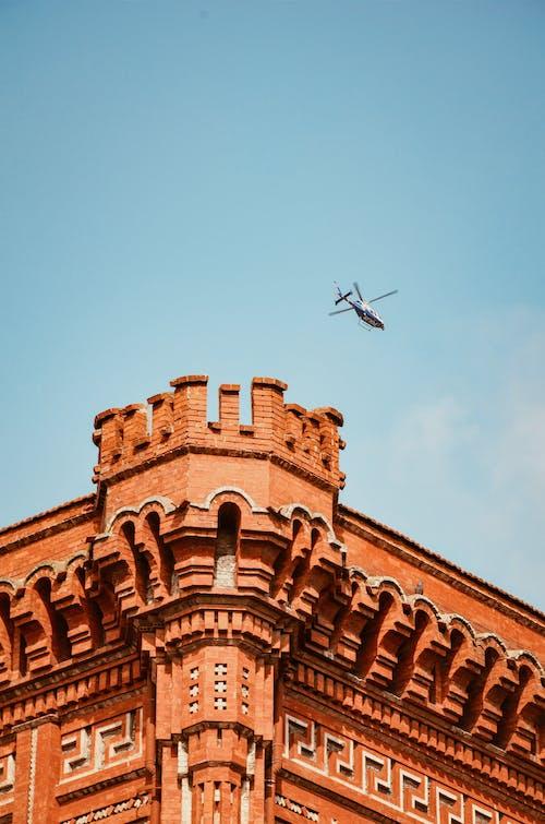 Ingyenes stockfotó építészet, épület, helikopter, repülés témában