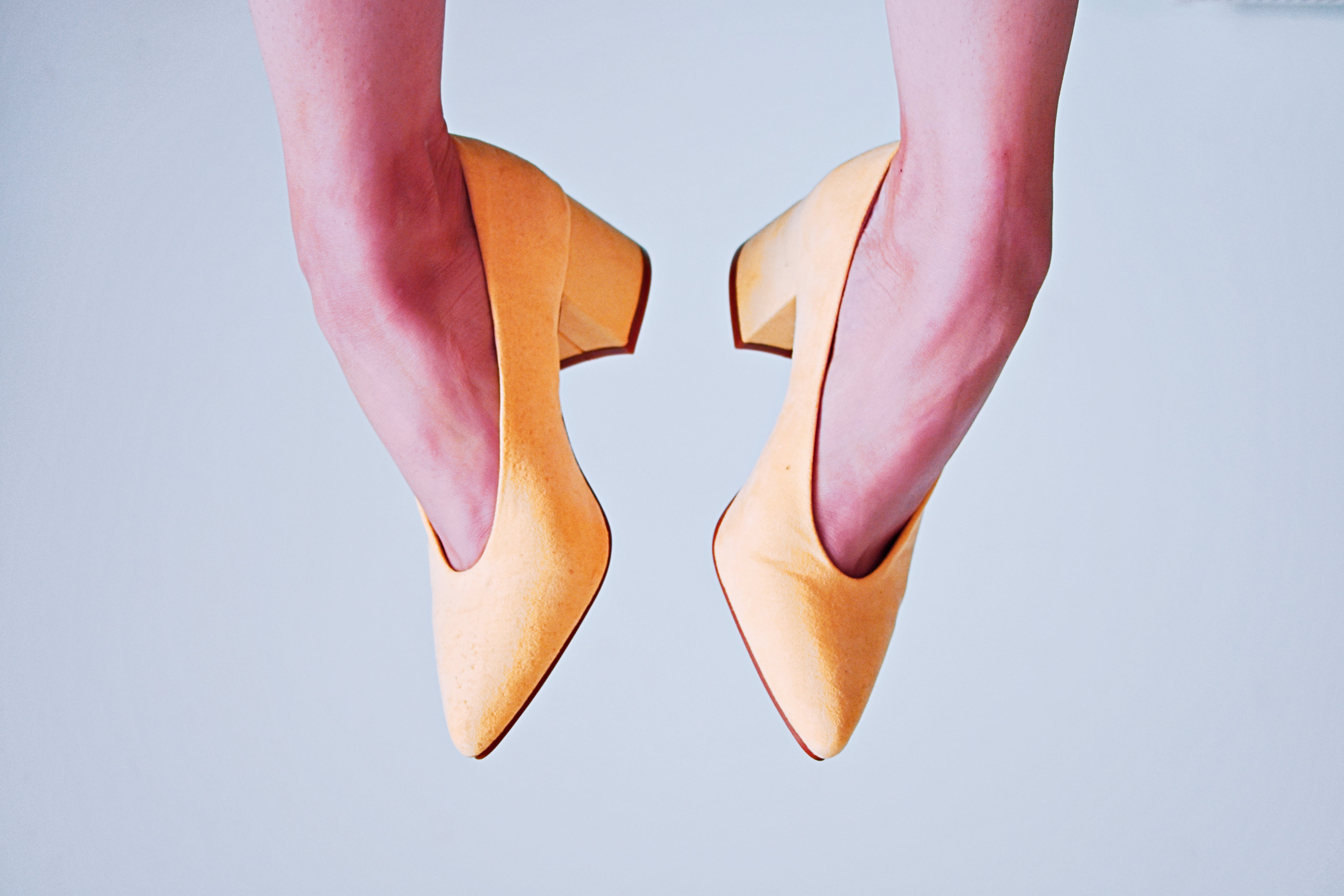 Woman With Pair of Yellow Leather Heeled Shoes