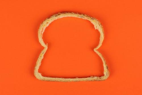 Δωρεάν στοκ φωτογραφιών με περιγράμματα, πορτοκαλί φόντο, ψωμί, ψωμί κρούστα