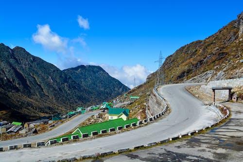 Kostnadsfri bild av berg, blå himmel, högland, kulle