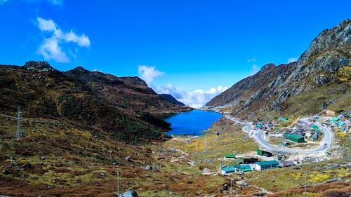 Kostnadsfri bild av berg, blå ton, dramatisk himmel, kulle