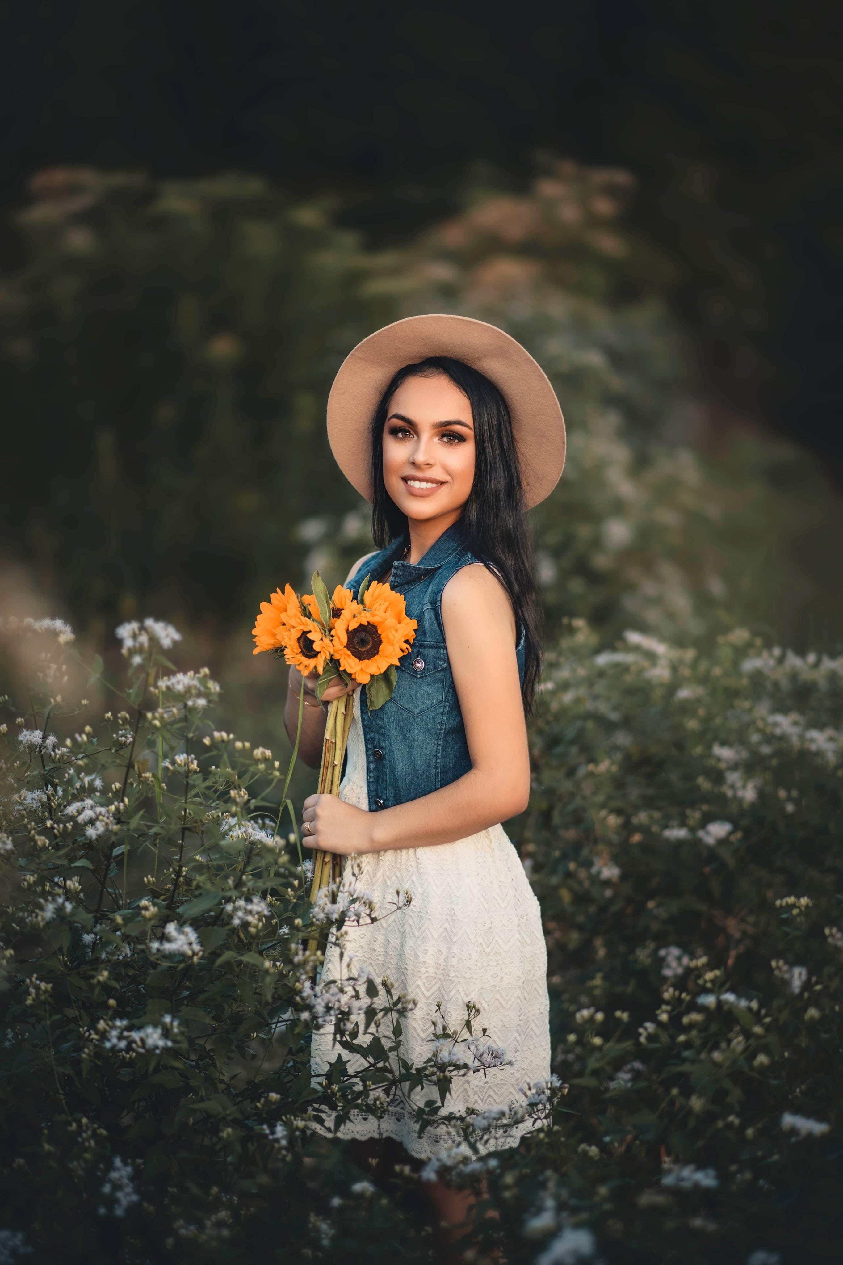 Woman Holding Bouquet of Sunflowers