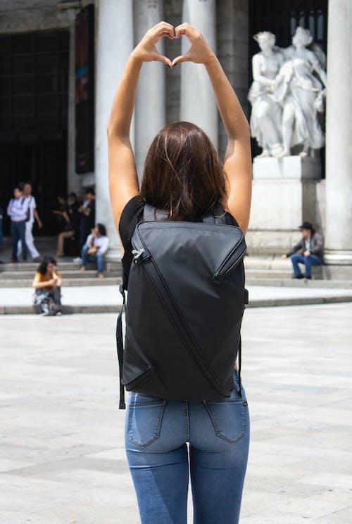 Free stock photo of back, backpack, girl, heart shape