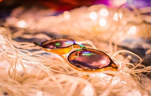 Kostnadsfri bild av bokeh, färgglada solglasögon, ljusreflektioner, natt