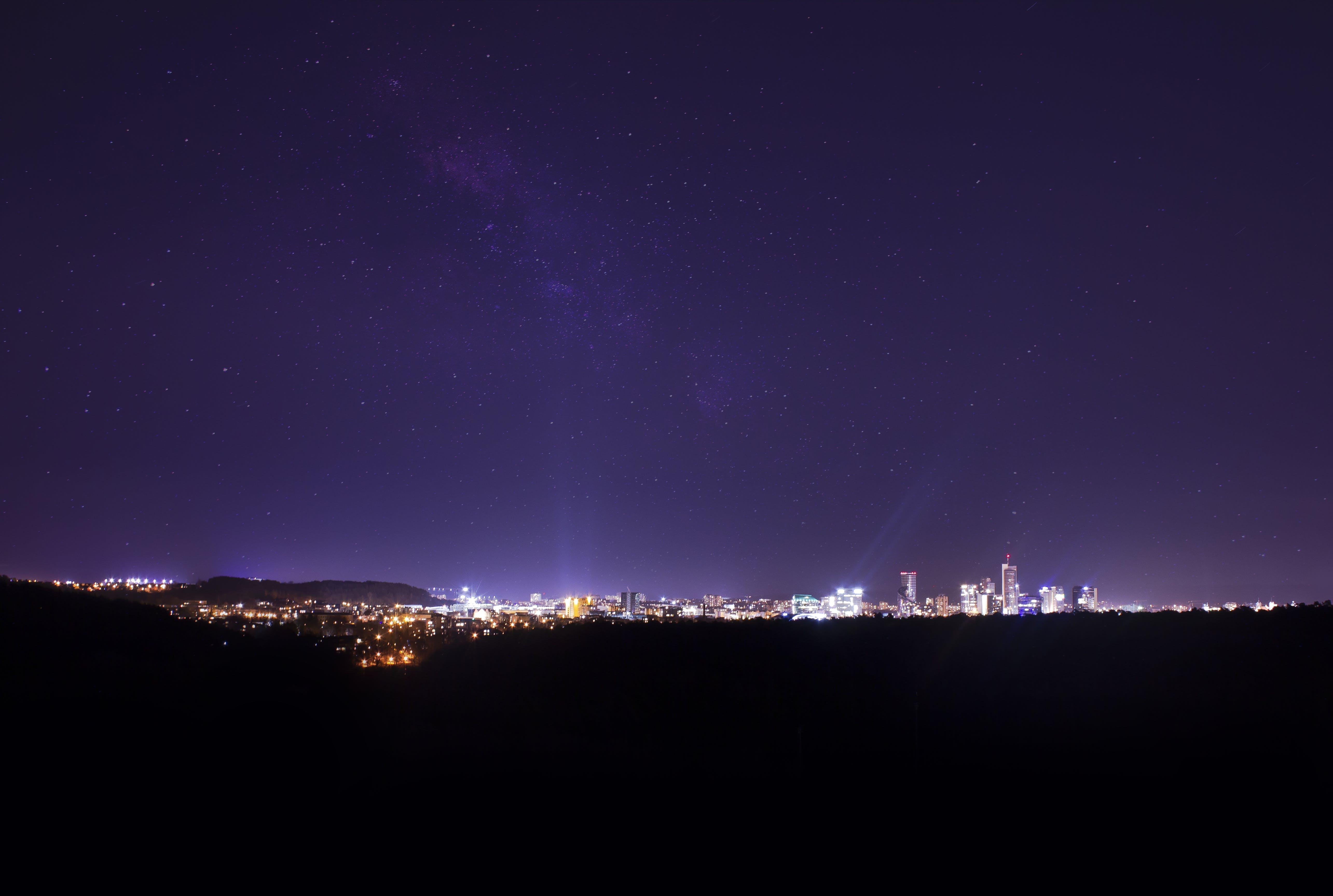 Free stock photo of city lights, night lights, purple, purple sky