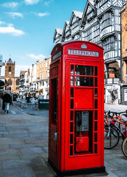 Selective Focus Photography Of Red Telephone Booth