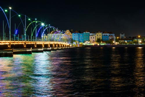 Assorted-color Buildings Near Body of Water at Night
