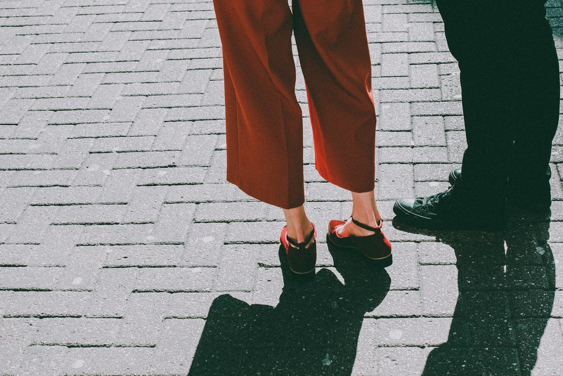 Two Person Standing on Brick Pavement